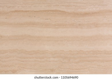 Natural beige travertine texture for your new design. High resolution photo.