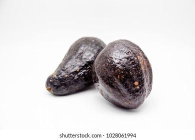 natural black avocado fruits on white background