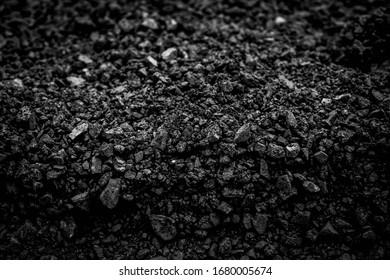 Natural black coals for background design. Industrial coals. Volcanic rock energy on earth.