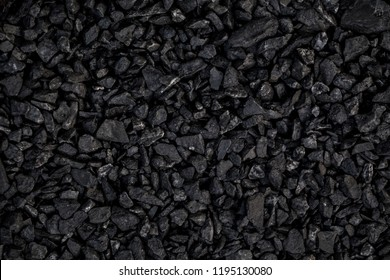 Natural black coals for background. Industrial coals. Volcanic rock backdrop design.