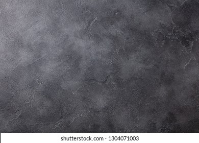 Natural black slate stone background pattern with high resolution. Top view. Copy space. - Shutterstock ID 1304071003