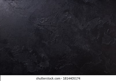 Natural black stone background pattern with high resolution. Top view. Copy space.