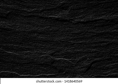 Natural black stone texture and background