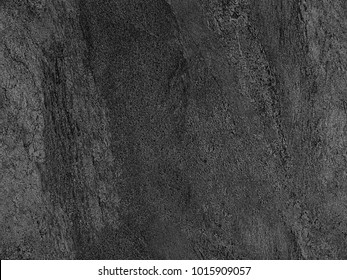 Natural black volcanic seamless stone texture venetian plaster background. Dark volcanic rock venetian plaster stone texture grain pattern. Black seamless grunge charcoal background texture rock