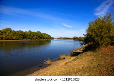 A natural blurred landscape of the river in autumn at sunset. Astrakhan Region, Russia