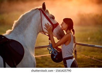 Natural bond between young woman and her horse, best friends