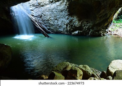 The Natural Bridge waterfall at Springbrook National Park in Queensland Australia.