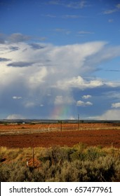 Natural Bridges National Monument, Vertical Rainbow under Stormy Clouds