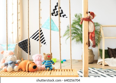 Natural bright baby playroom with eco friendly fabrics and toys
