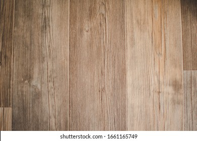 Natural bright vertical brown wood pattern texture background linoleum on the ground or wall