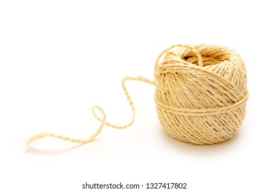 Natural brown coiled ball of coarse, jute, twine or string isolated on white background