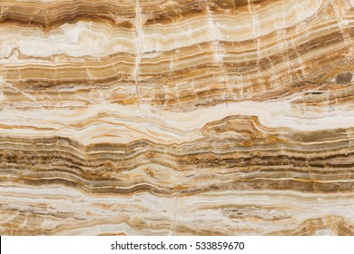 Natural brown onyx marble, stone texture. High resolution photo.