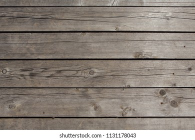 Natural brown wooden vertical texture and background