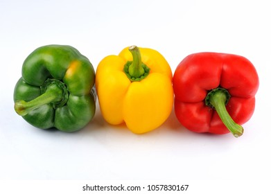 Natural capsicum. Group of three capsicum isolated on the white background.