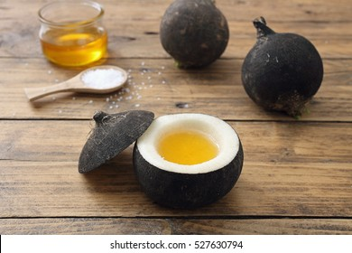 natural care black ripe with sugar and honey on rustic table background