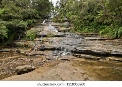 Natural cascade waterfall in Blue Mountains. Australia.