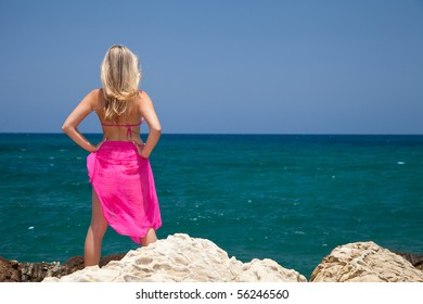 Natural caucasian woman tanning on exotic beach