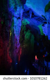 Natural cave with crazy colorful illumination