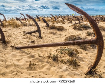 Natural Cemetery of Marine Anchors at Barril Beach on the southern Portuguese coast of the Atlantic.