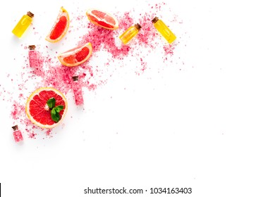 Natural citrus cosmetics. Spa salt near grapefruit on white background top view copy space