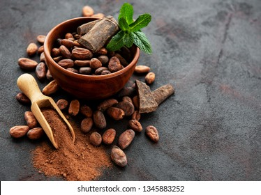 Natural  cocoa beans and cocoa powder  on a black  background