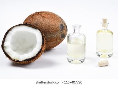 Natural coconut oil in bottles on white background.