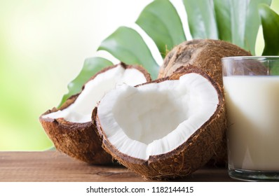 natural coconut open in half on wood and leaf