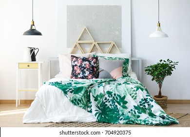 Natural colored bedroom with delicate furniture and botanical prints