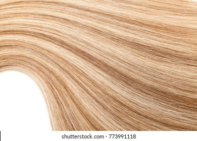 Natural colored shiny healthy human hair bundles for extension and weave wigs making. Haircare technology, style and beauty concept. Abstract texture background. Detailed closeup studio shot
