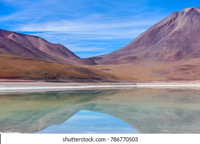 The natural colors of the green lagoon in the Siloli desert near the border of Chile and the Uyuni Salt Flat in Bolivia, South America
