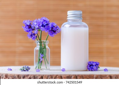 natural cosmetic bottle with fresh lavender flowers, selective focus