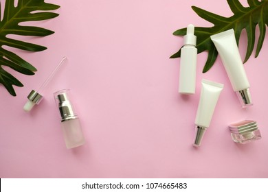 natural cosmetic makeup , organic skincare serum product packaging with leaves herb on nature beauty concept, herb bio and spa concept.pink background.