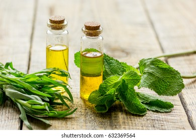 natural cosmetic oil with fresh mint on light wooden table background