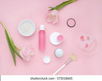 Natural cosmetic pink flat lay with flowers. Top view.