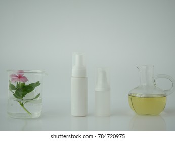 natural cosmetic skincare serum packaging with leaf, home made oil and beauty vitamin ingredient.organic product research the blank bottle container ,bio science . alternative medicine. spa.