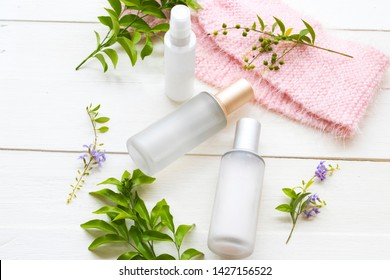 natural cosmetics collagen water ,toners serum therapy  health care for skin face with knitting wool scarf of lifestyle woman relax arrangement flat lay style on background white