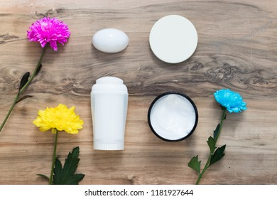 Natural cosmetics and flovers, leaves on a wooden table