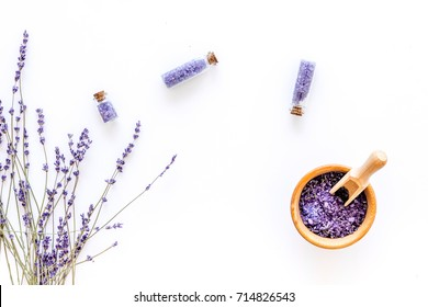 natural cosmetics with lavender and herbs for homemade spa on white background top view mock up