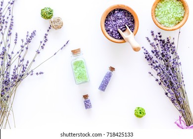 natural cosmetics with lavender and herbs for homemade spa on white background top view