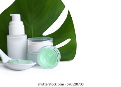 Natural cosmetics and leaf on white background