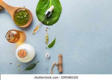 Natural cosmetics, oils for skin care on a light background. Homeopathic oils, milk, soap. Vegetable serum for skin   Beauty blogger concept.