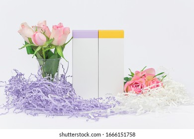 Natural cosmetics SPA mock-up on white background with fresh flowers and soft paper filler. Organic cosmetic packaging Cardboard Box, Day and night cosmetic product concept