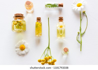 natural cosmetics and wildflowers on a white background close-up