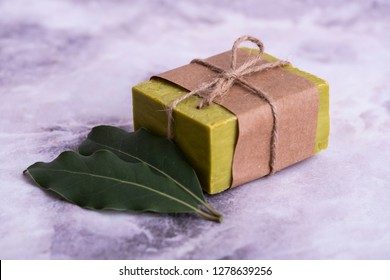 Natural daphne soap bar with daphne lef.