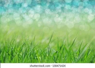 Natural defocused background - grass and water. Spring or holiday by a lake.