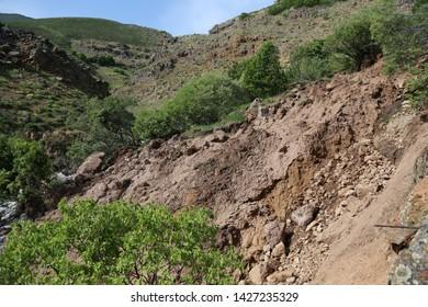 Natural disaster. Landslide after downpour