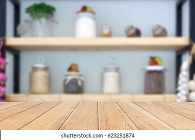 Natural empty pattern wooden table with blurred kitchen, various food ingredients and utensils. interior background - can be used for display or montage your products.
