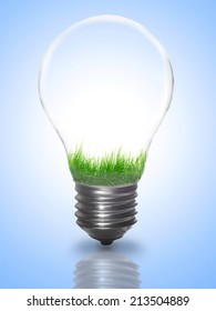 Natural energy concept. Lightbulb with summer meadow, green grass. Electric light bulb grass inside as symbol of green energy, power. Nature eco friendly technology, industry, plant