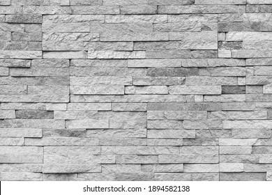 Natural facade stone decoration quartzite background texture. modern granite stone wall