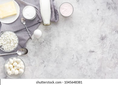 Natural farm products. Milk, cottage, eggs, cheese, yougurt on grey background top view copy space. Monochrome